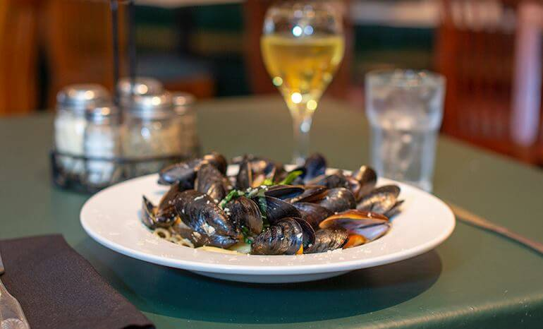 Mussels over Penne in a white wine garlic broth